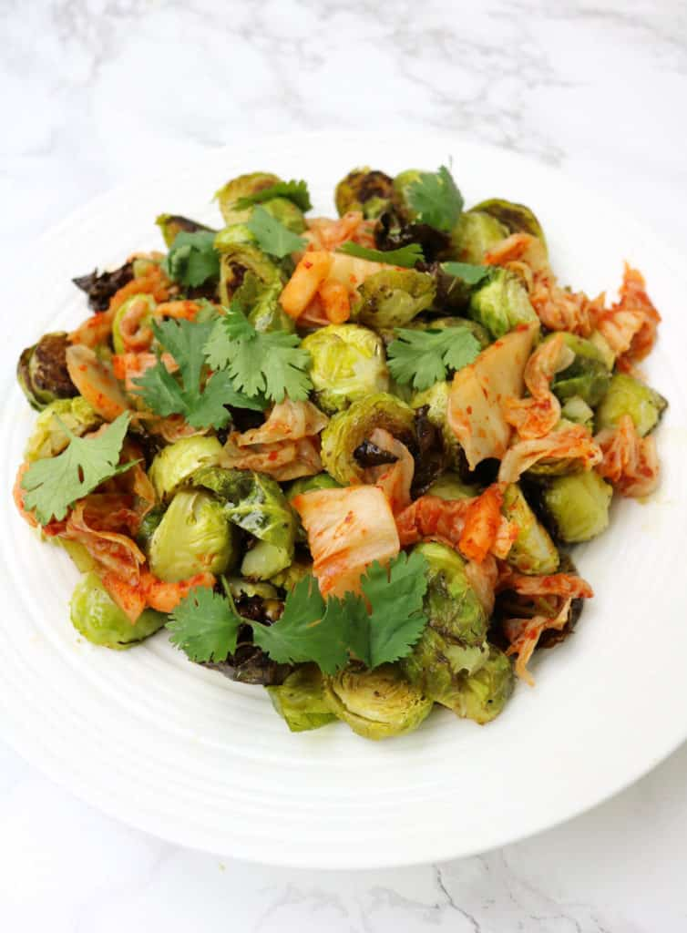 Roasted Brussels Sprouts with Kimchi - Paleo + Whole30 Recipe! A delicious way to add more fermented food to your meals!